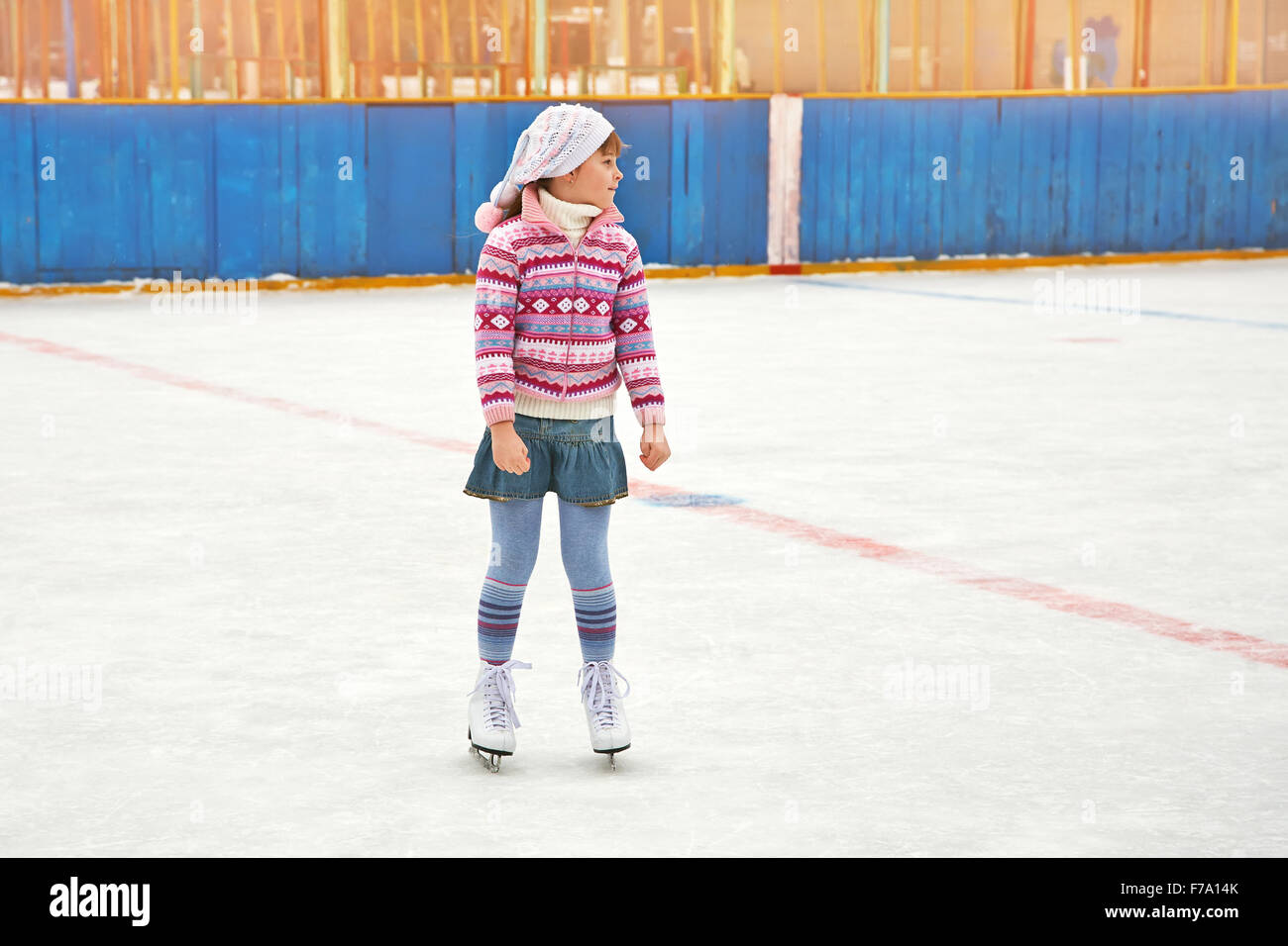 girl ice skating on rink - Stock Image