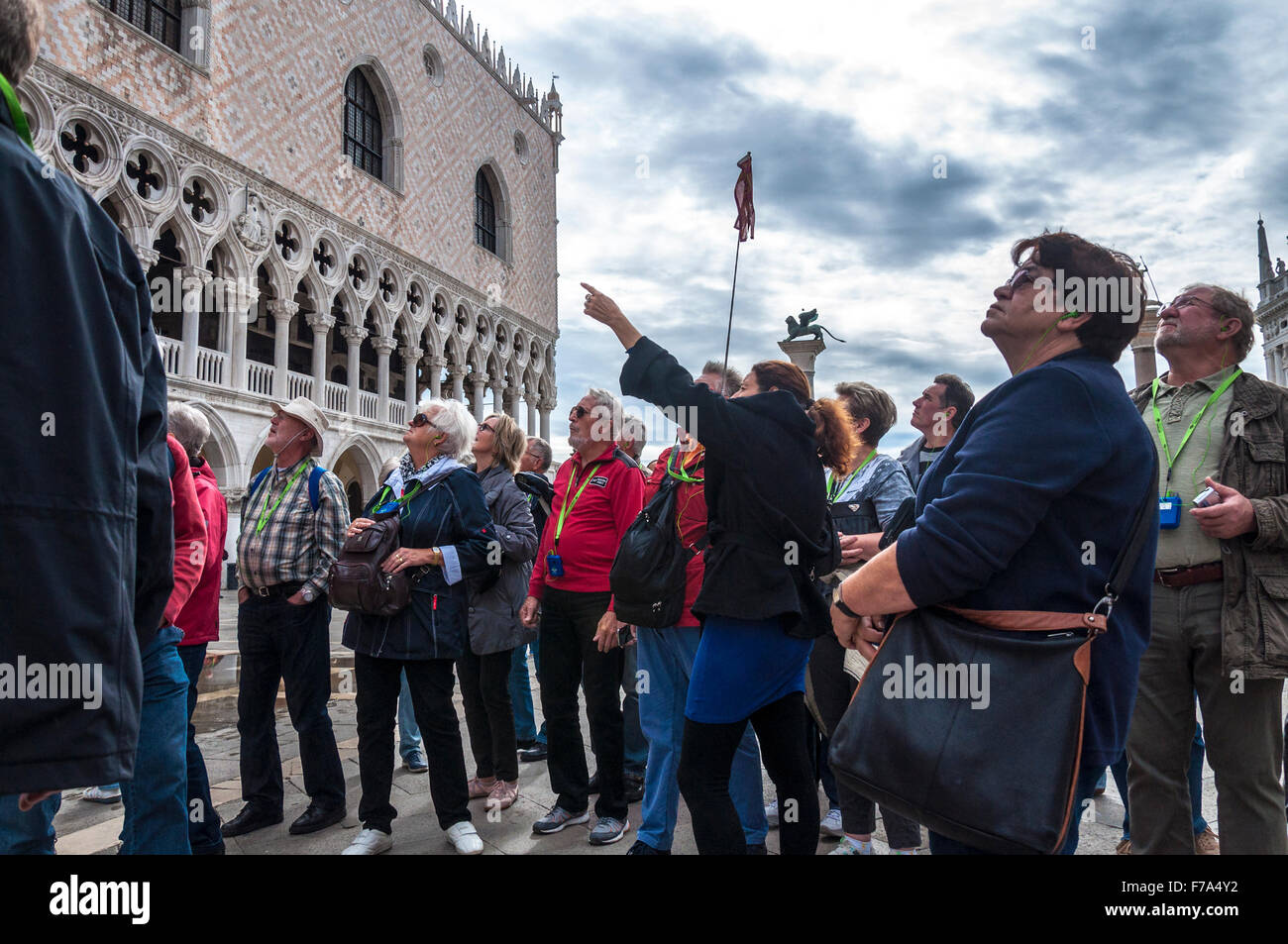 Tourists guided tour Piazzetta San Marco in Venice, Italy - Stock Image