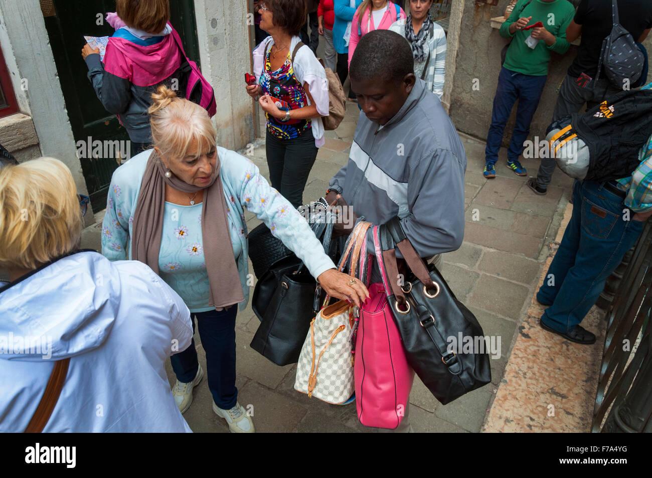 66ba0f6b3f Selling counterfeit imitation designer handbags in Venice, Italy. illegal  street vendor. - Stock