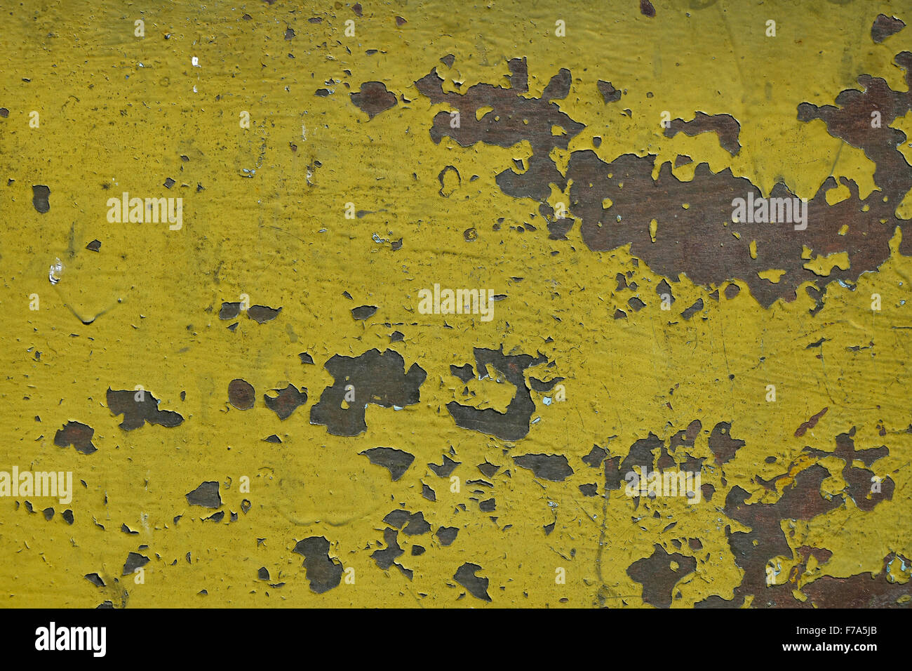 stained corroded rusty yellow khaki painted metal surface with