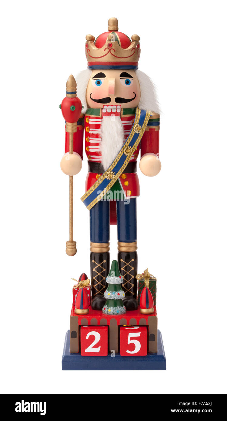 Antique Christmas Nutcracker Monarch holding a scepter. - Stock Image