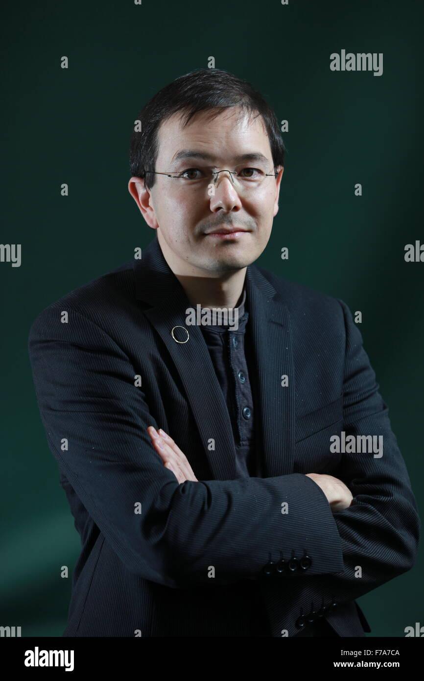 A portrait of Shaun Tan in Charlotte Square Gardens during The Edinburgh International Book Festival. - Stock Image