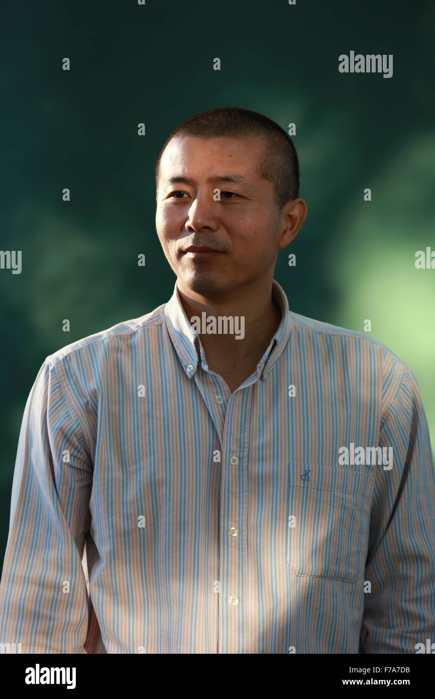 A portrait of Bi Feiyu in Charlotte Square Gardens during The Edinburgh International Book Festival. - Stock Image