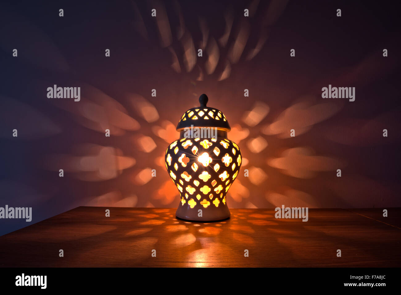 a decorative low level light with a moorish pattern cut away