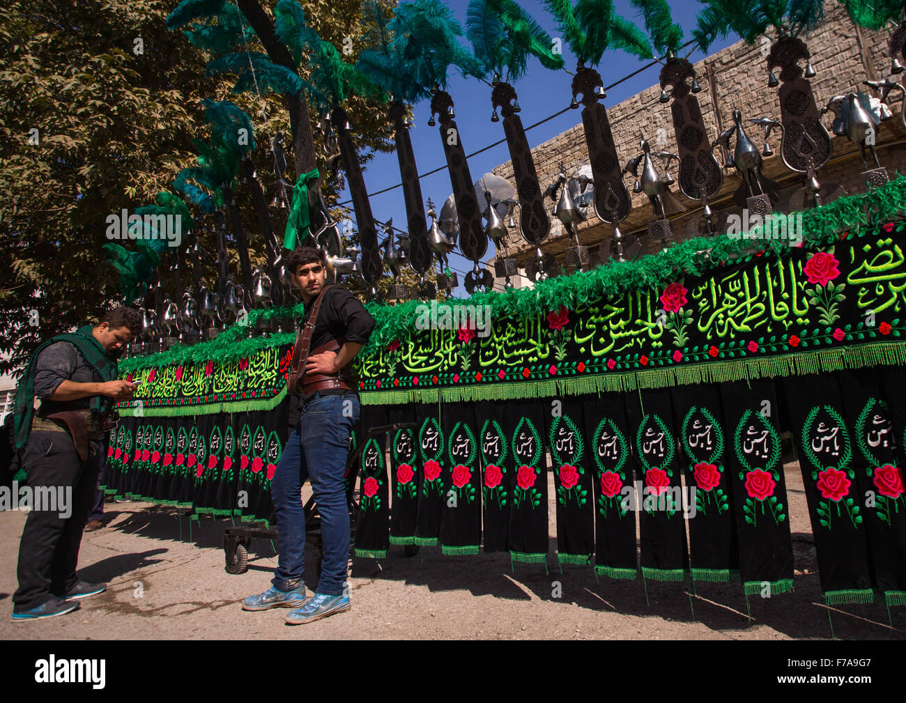 Iranian Shiite Muslim Men In Front Of An An Alam On Tasua Celebration, Lorestan Province, Khorramabad, Iran - Stock Image