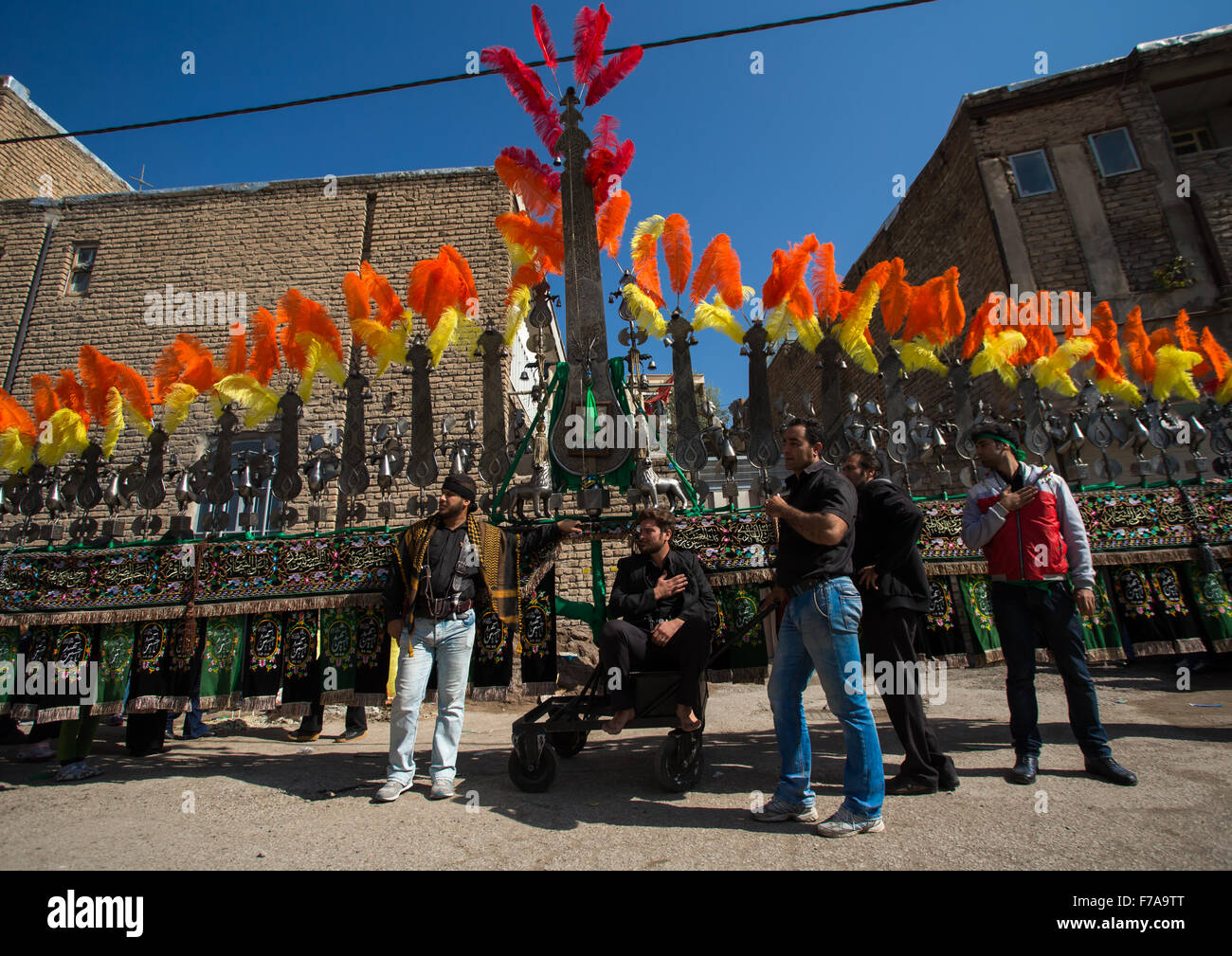 Iranian Shiite Muslims Men In Front Of An An Alam On Tasua Celebration, Lorestan Province, Khorramabad, Iran - Stock Image