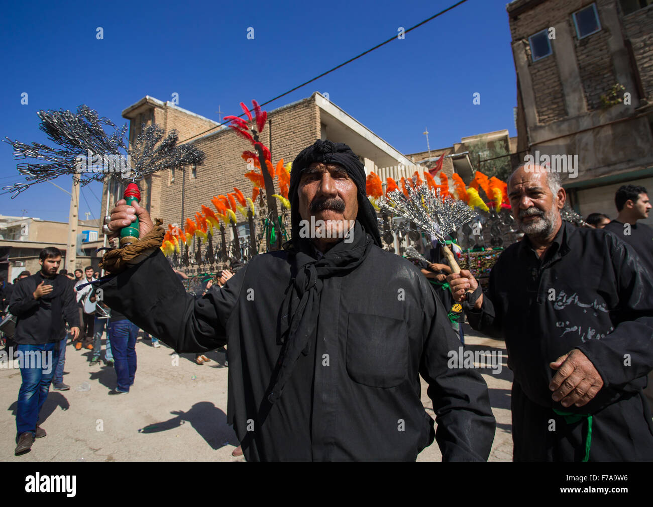 Iranian Shiite Muslim Men Beating Themselves With Chains In Front Of An Alam On Tasua Celebration, Lorestan Province, - Stock Image