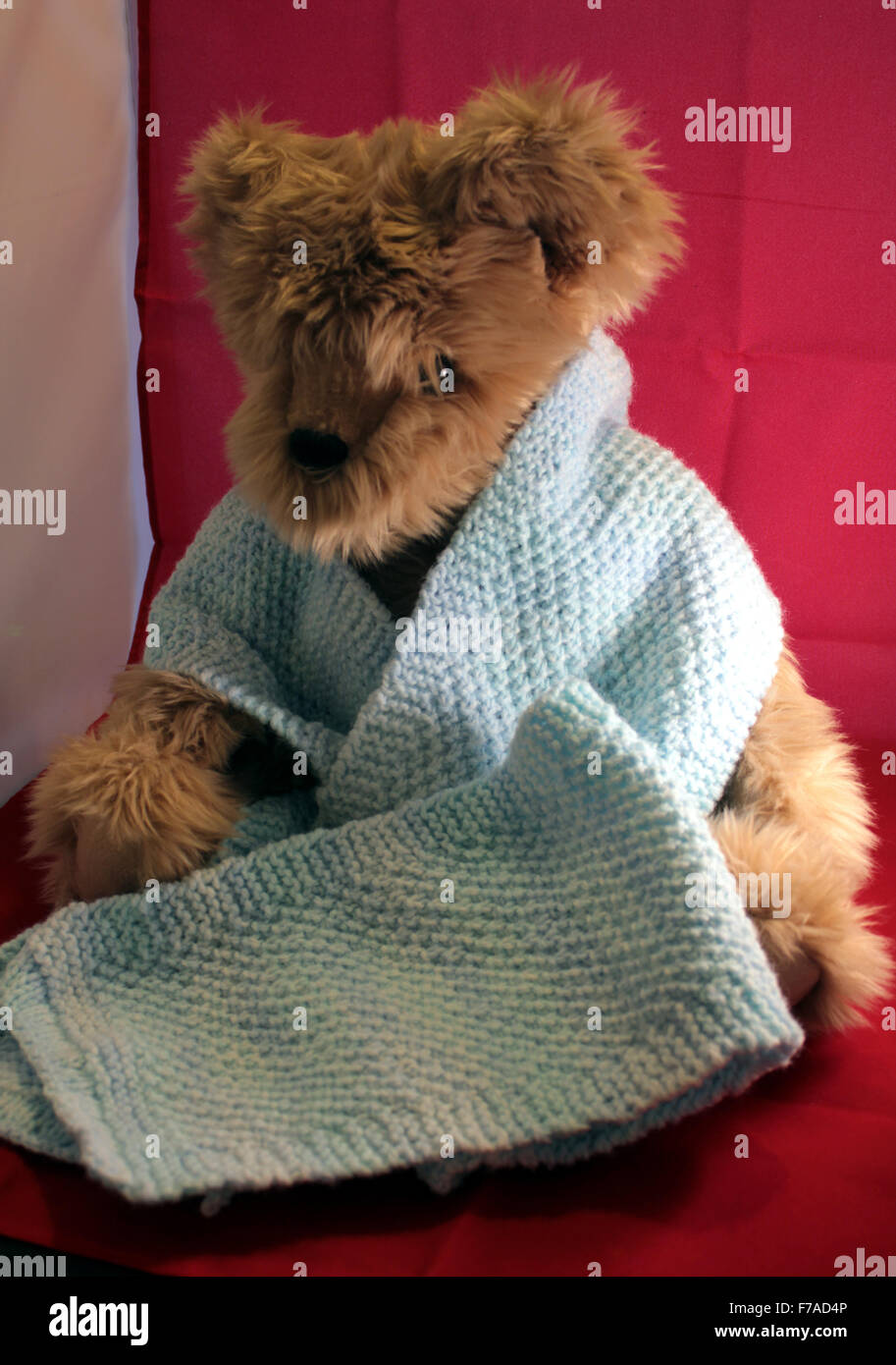 Machine Knitted Stock Photos Images Alamy Mom N Bab Sweater Blue Stripe Scarf Hand Being Worn By A Teddy Bear Image