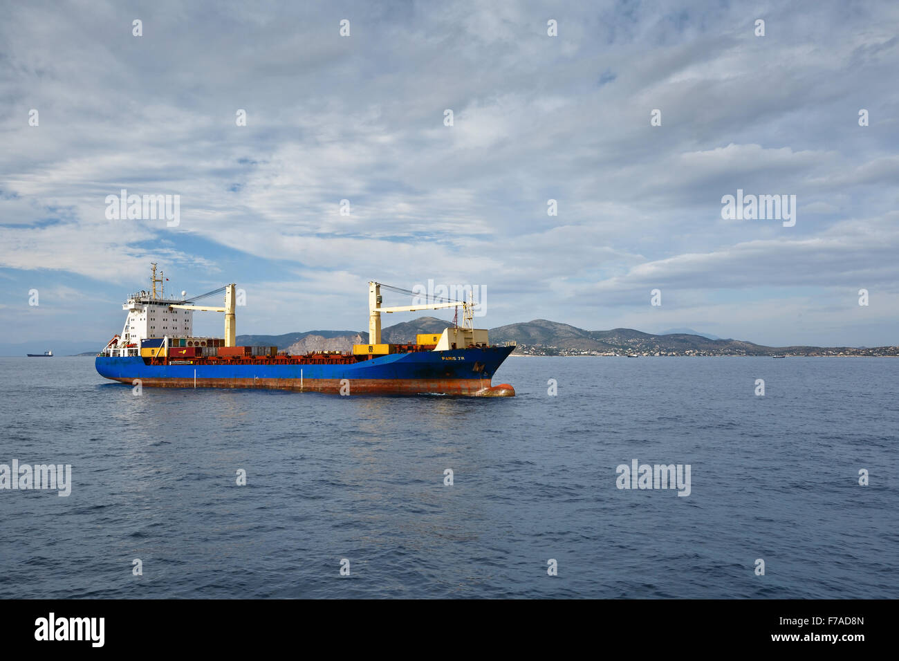 Container ship heading to the port of Piraeus, Greece - Stock Image