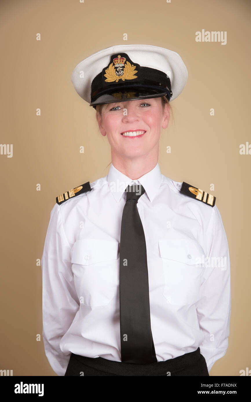 Female naval Lt Commander in uniform standing to attention - Stock Image