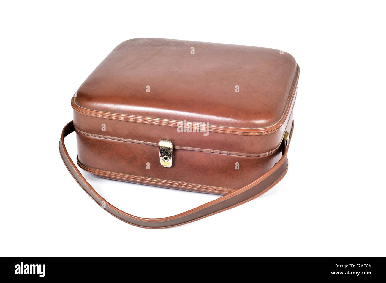 an old square brown leatherette suitcase on a white background - Stock Image