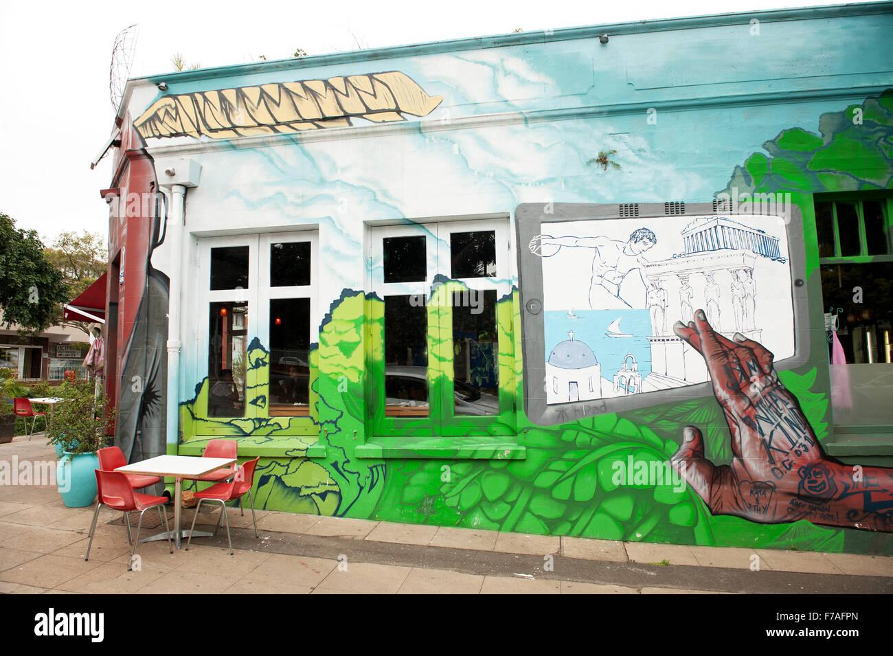 Sidewalk cafe in the Glenwood suburb of Durban South Africa.  Trendy restaurant in the Morningside neighbourhood - Stock Image
