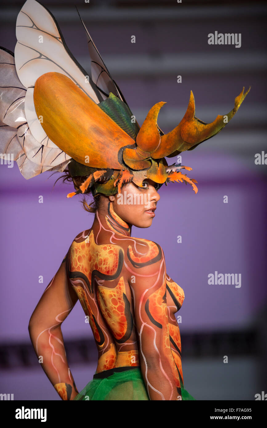 Model in fashion show wearing body paint design by Colombian designer Bodypaint Anubis - Stock Image