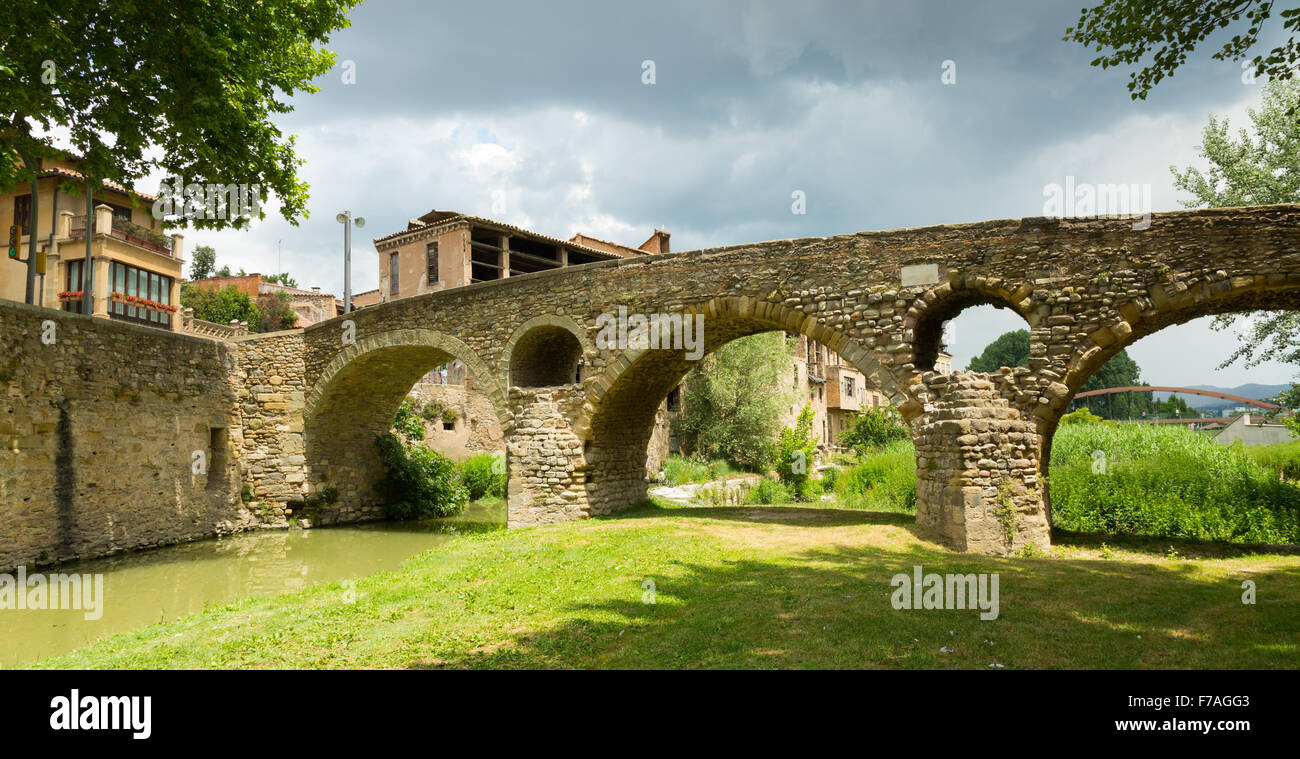 View of old stone bridge over  river  in Vic. Catalonia, Spain Stock Photo