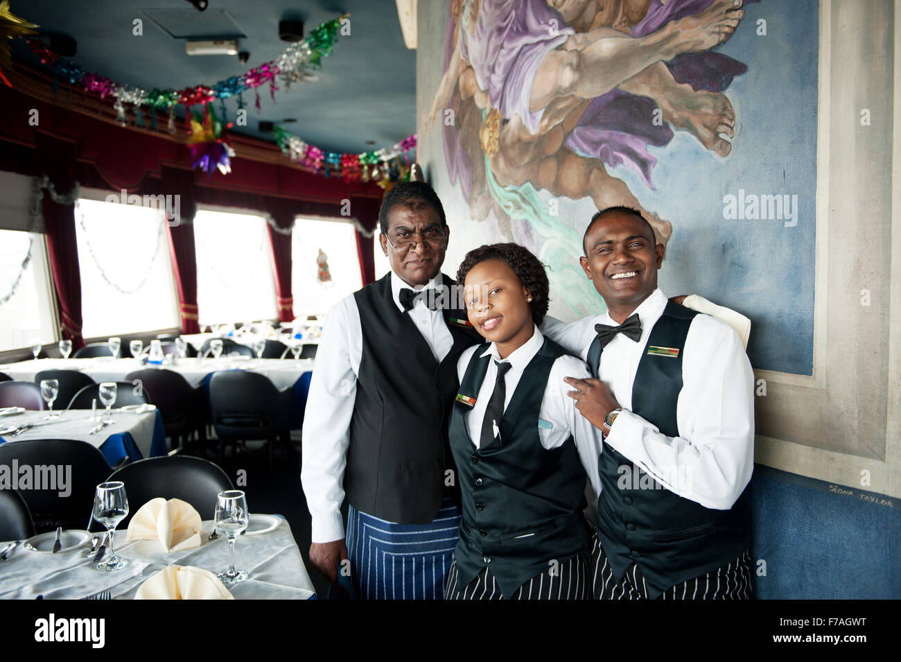 Waiters at the Roma Revolving Restaurant in Durban South Africa. - Stock Image