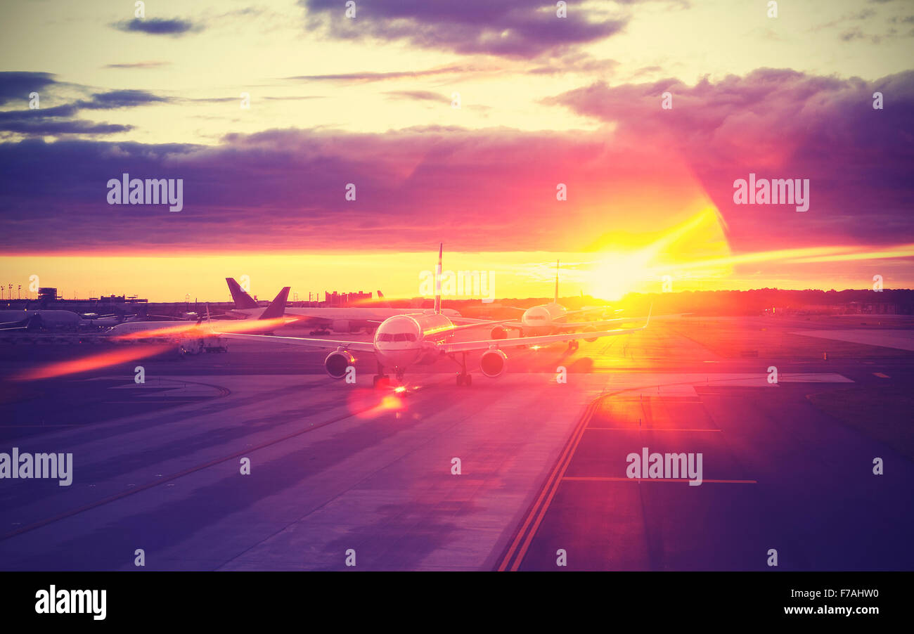 Vintage filtered picture of airport at sunset, travel concept, lens flare effect. - Stock Image