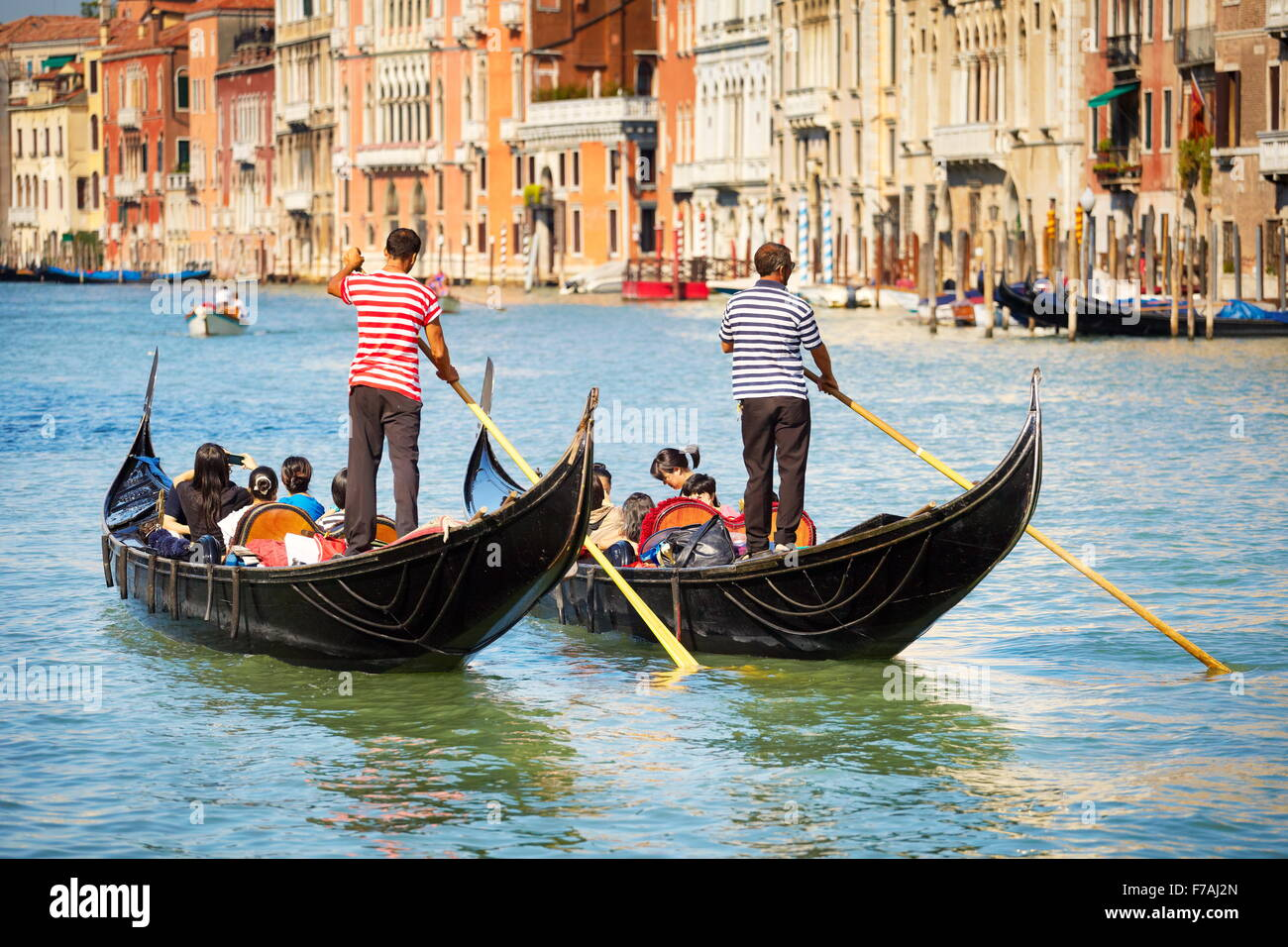 Grand Canal (Canal Grande) - two venetian gondola with tourists, Venice, Italy - Stock Image