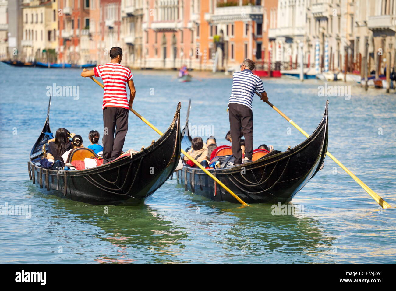 Tourists in venetian gondolas on Grand Canal (Canal Grande), Venice, Italy Stock Photo