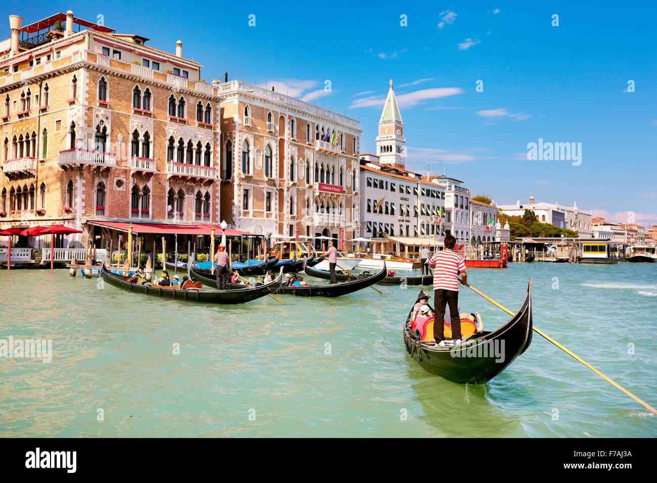 Gondolier flowing gondola, Grand Canal (Canal Grande), Venice, Veneto, Italy, UNESCO - Stock Image
