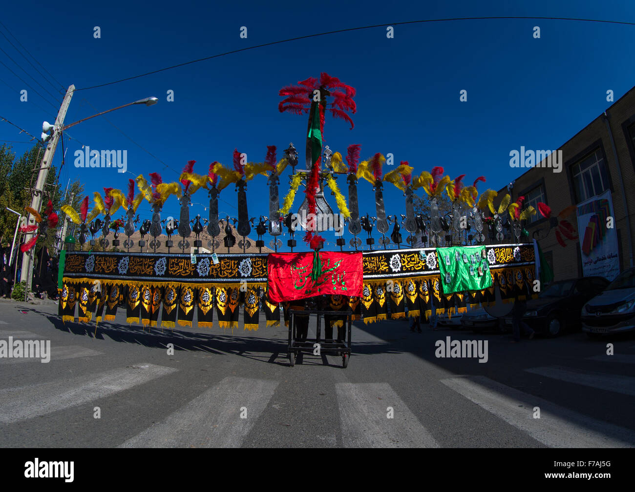 Iranian Shiite Muslim Men Carry An Alam On Ashura, The Day Of The Death Of Imam Hussein, Kurdistan Province, Bijar, - Stock Image