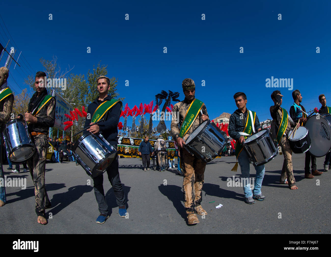 Iranian Shiite Muslim Men Playing Drums In Front Of An Alam During Ashura, The Day Of The Death Of Imam Hussein, - Stock Image
