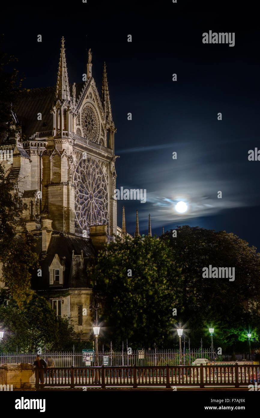 Full Moon Rising Behind Notre Dame, Paris France Stock Photo