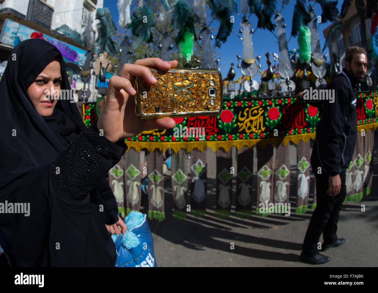 Iranian Woman Taking Pictures With A Mobile Phone Branded Louis Vuitton During Ashura, The Day Of The Death Of Imam - Stock Image
