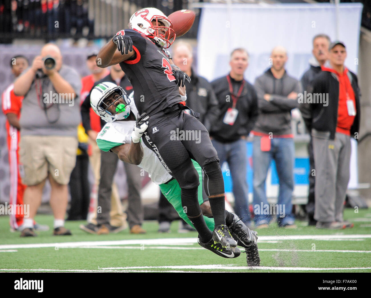 November 27 2015 Western Kentucky Hilltoppers wide receiver Taywan Taylor (2) gets pulled down by Marshall Thundering - Stock Image