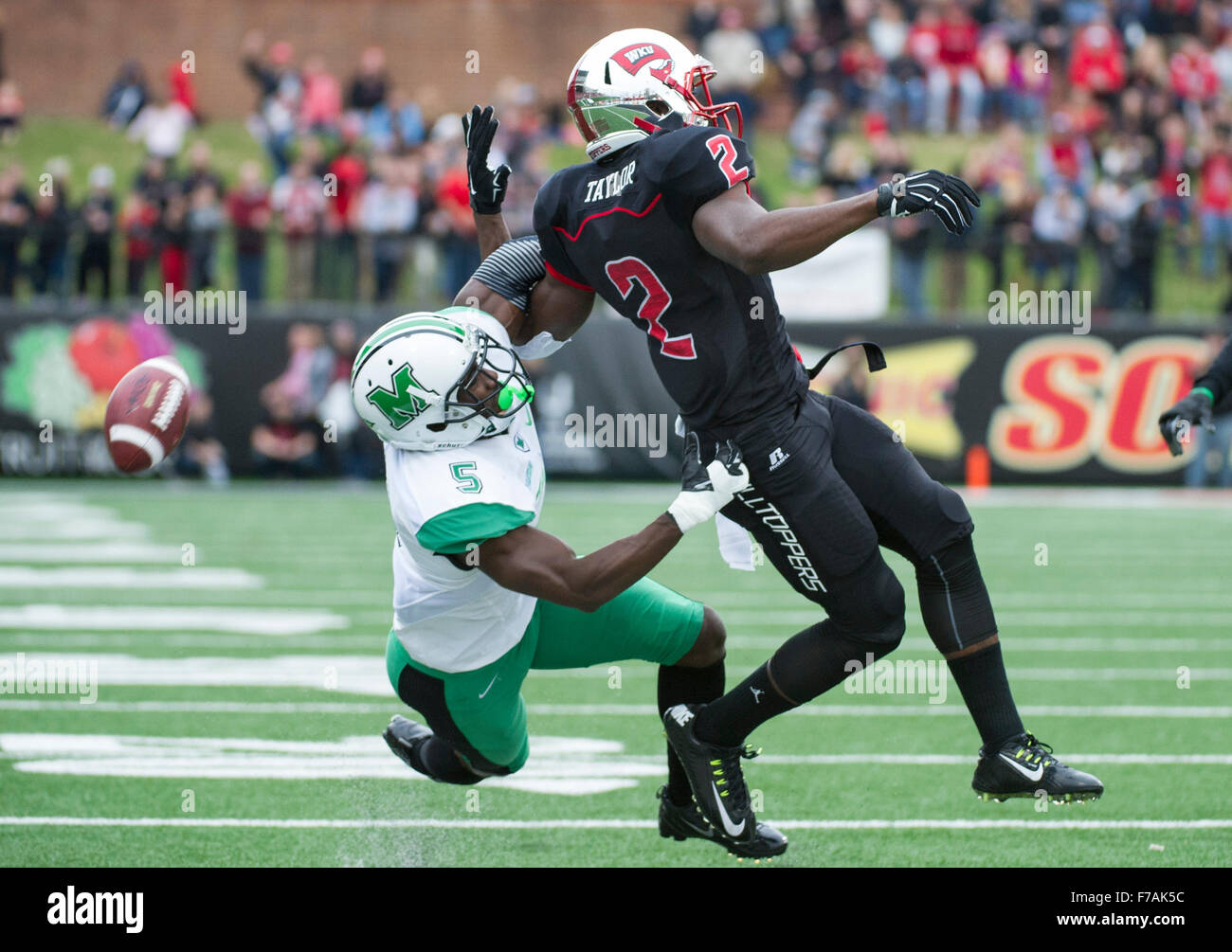 Bowling Green, Kentucky, USA. 27th Nov, 2015. Marshall defensive back Keith Baxter (5) commits a pass interference - Stock Image