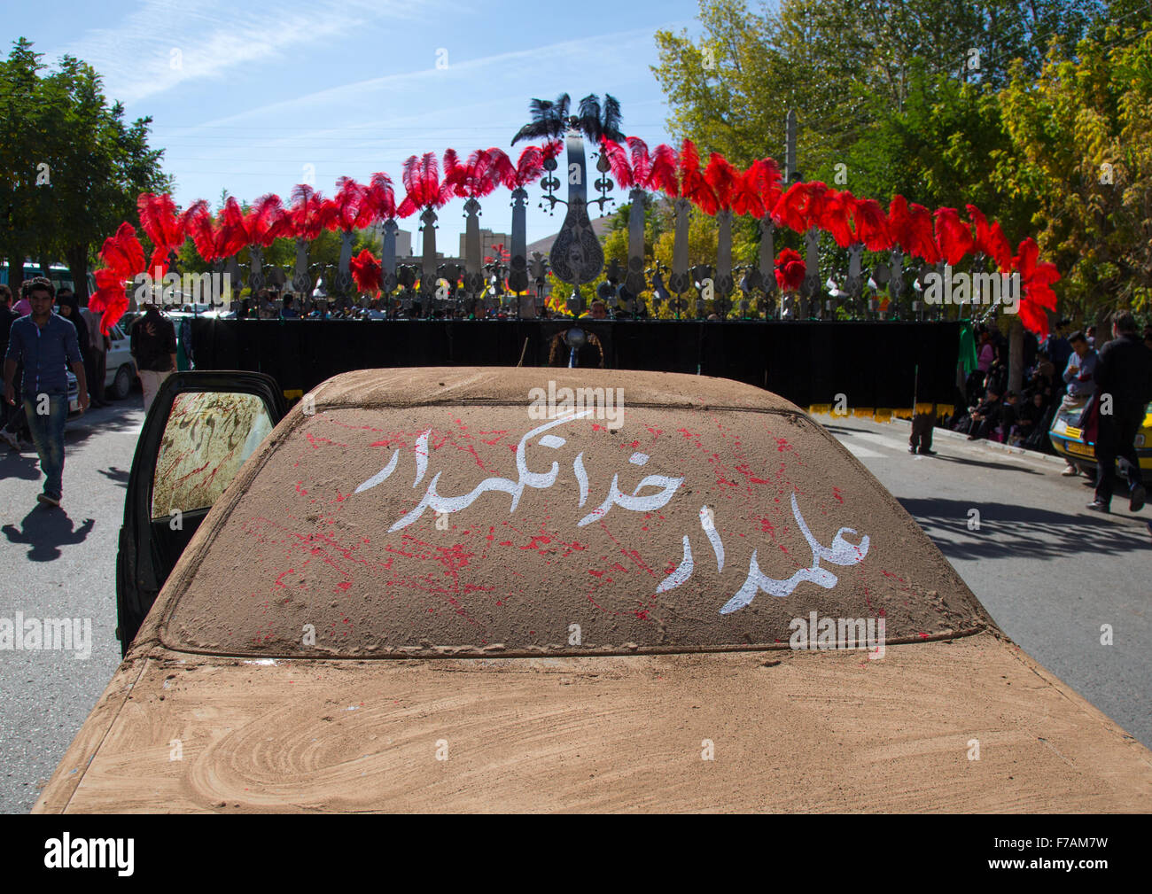 A Car Covered Of Mud In Front Of An Alam On Ashura, The Day Of The Death Of Imam Hussein, Kurdistan Province, Bijar, - Stock Image