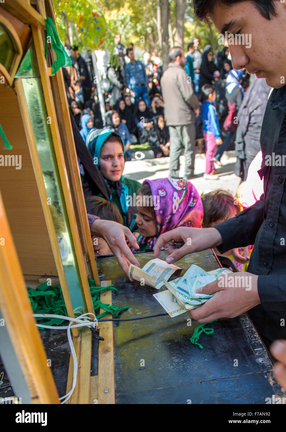 Iranian Shiite People Buying Green Ribbons To Make Wishes On Ashura, The Day Of The Death Of Imam Hussein, Kurdistan - Stock Image