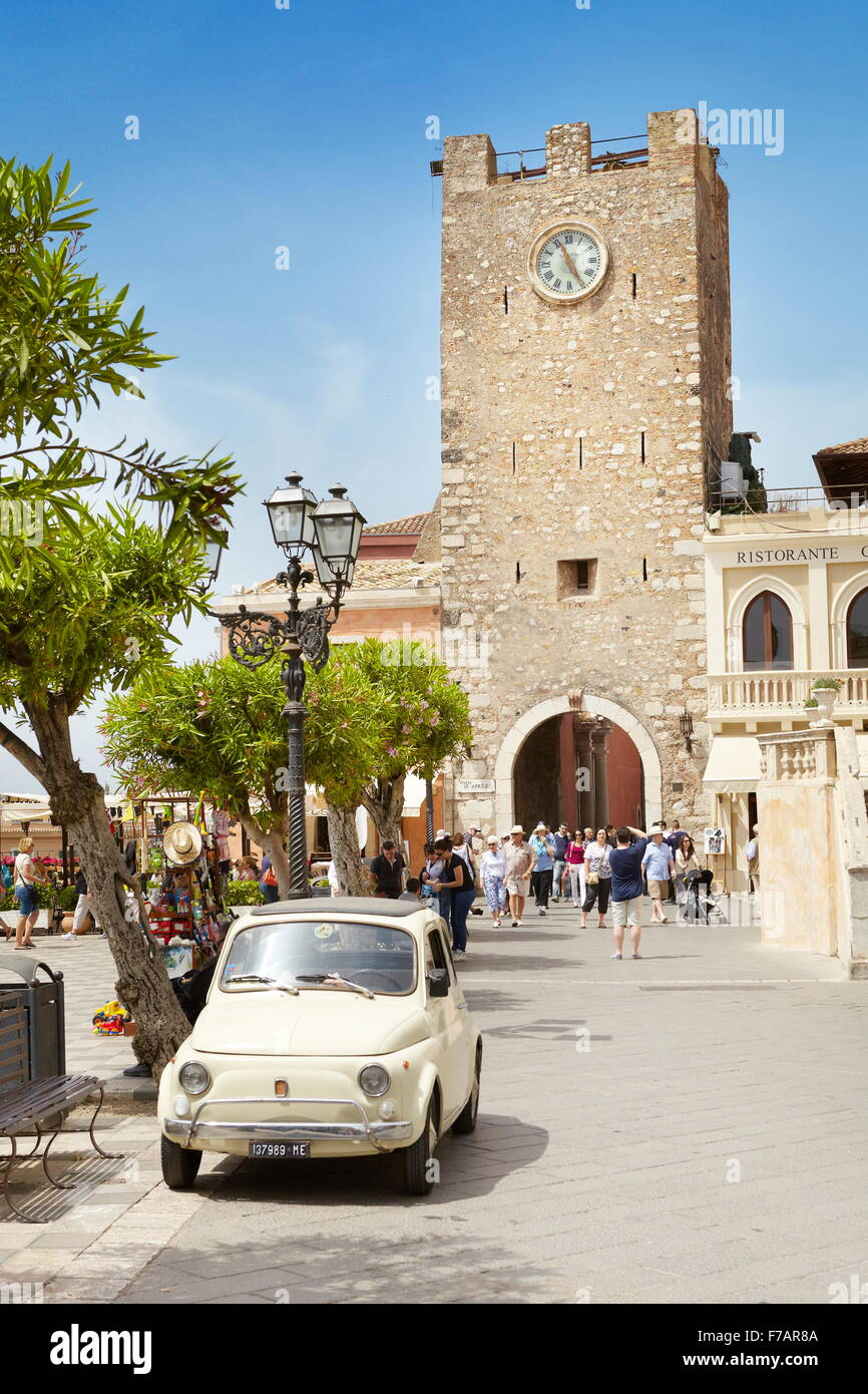 Fiat 500 car and Clock Tower in the background, Piazza IX Aprile, Taormina, Sicily, Italy - Stock Image
