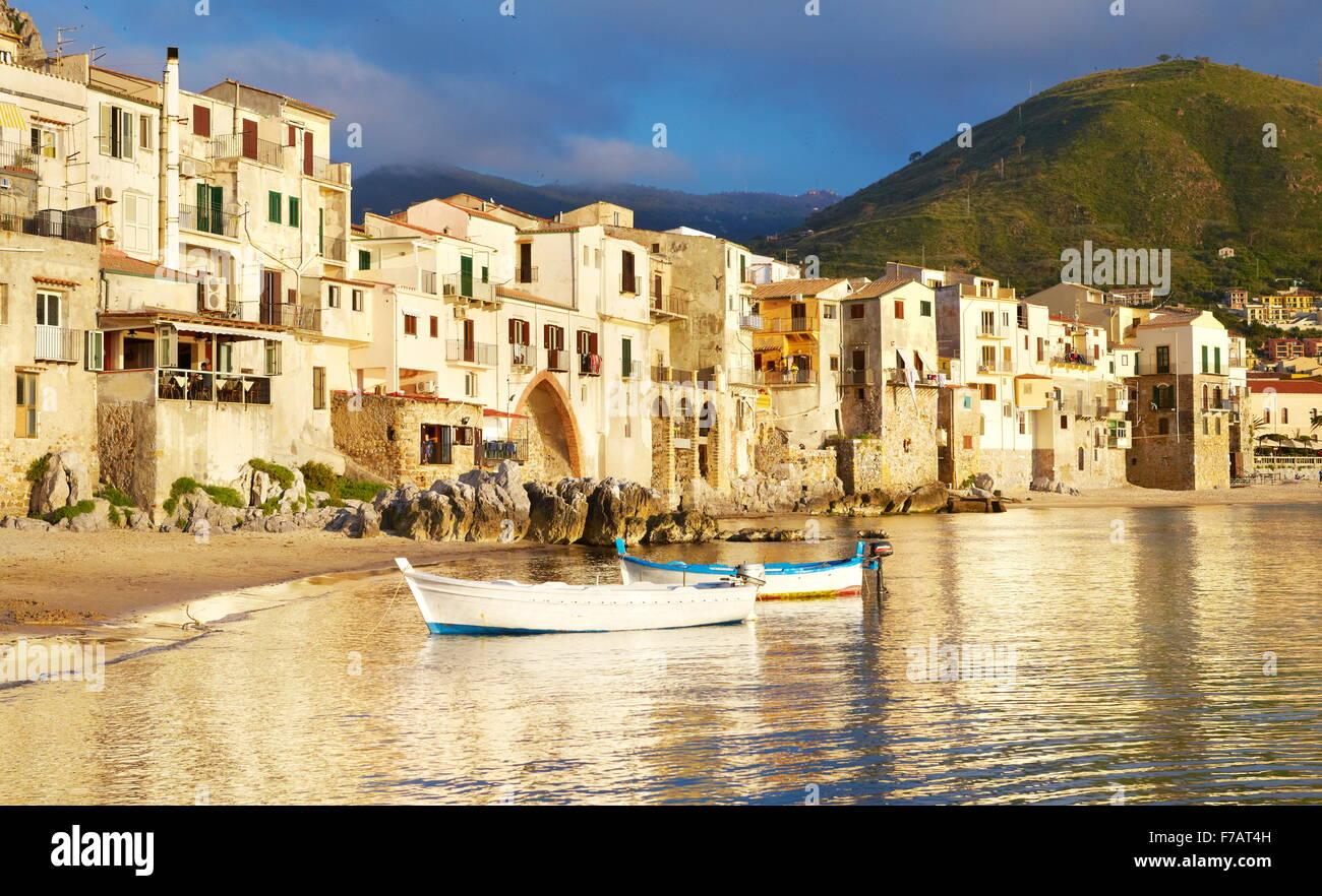 Medieval houses on the seashore, Cefalu, Sicily, Italy - Stock Image