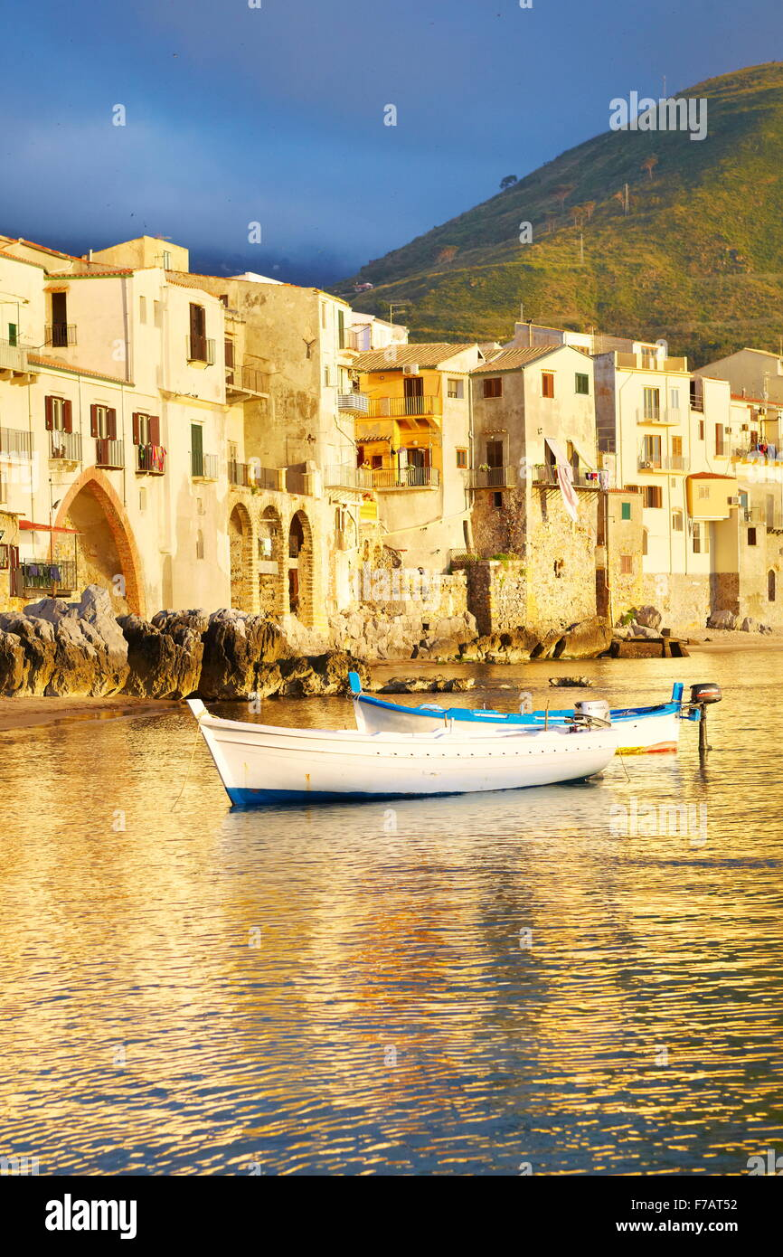 Cefalu medieval houses on the seashore, Cefalu Old Town, Sicily, Italy - Stock Image