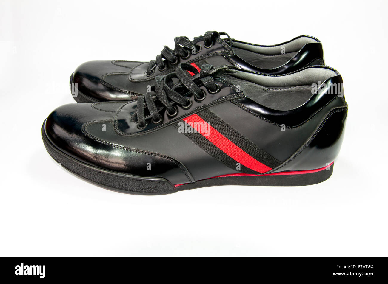 Black men shoes with red stripe isolated with white background - Stock Image