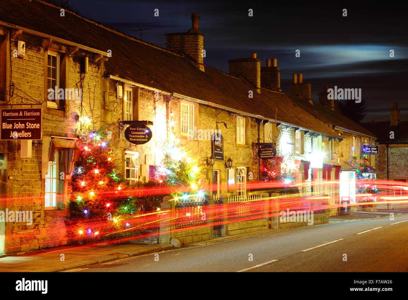 Decorated Christmas trees line the main street in Castleton; a traditional British village in the Peak District, Stock Photo