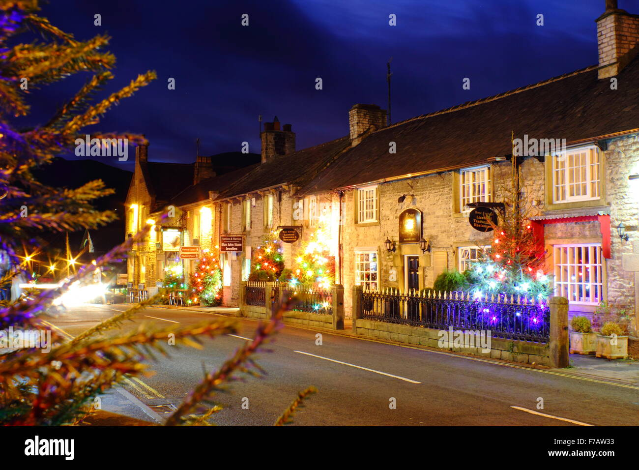 Decorated Christmas trees line the main street in Castleton; a traditional British village in the Peak District, - Stock Image