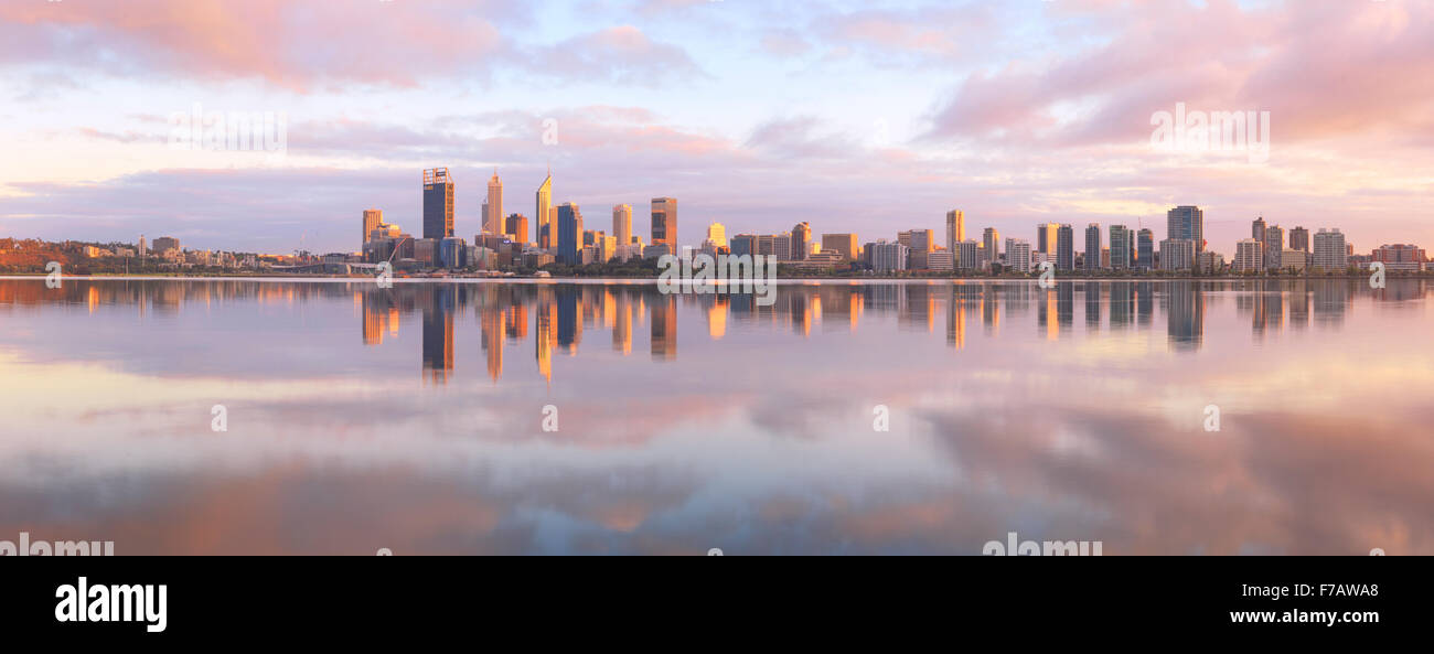 The city skyline reflected in the Swan River at sunrise - Stock Image