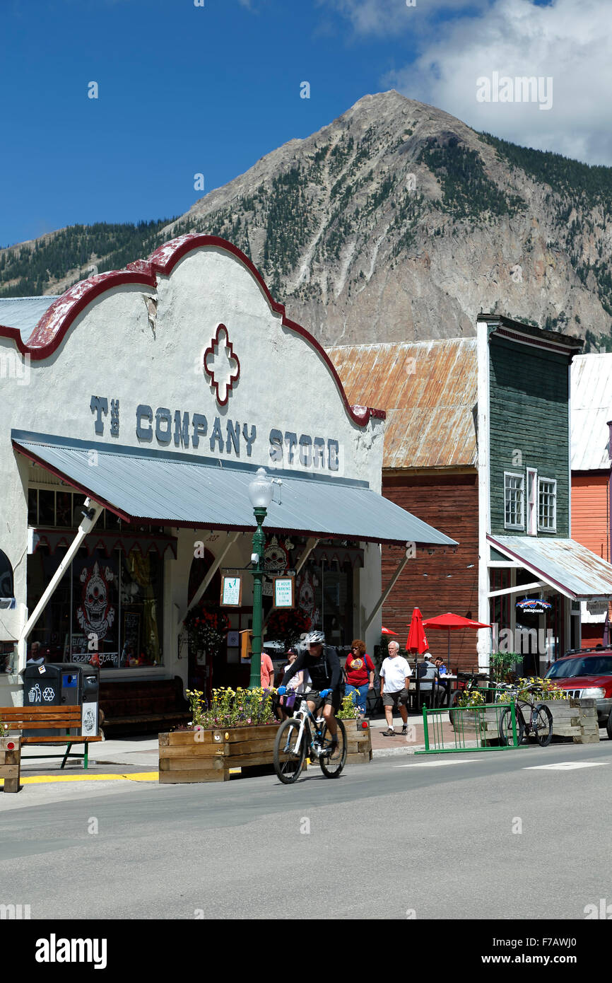 Historic Downtown, cyclist and Mount Crested Butte (12,162 ft.), Crested Butte, Colorado USA Stock Photo
