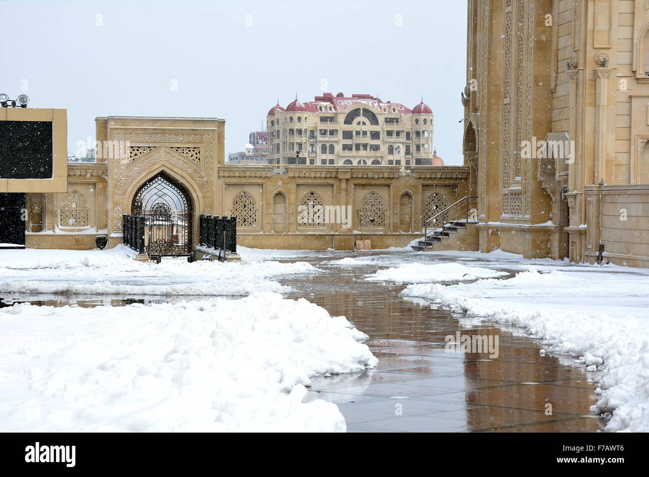 Snow outside within grounds of a Baku Mosque, in the capital of Azerbaijan.   BAKU, AZERBAIJAN - 31 JANUARY 2015 - Stock Image