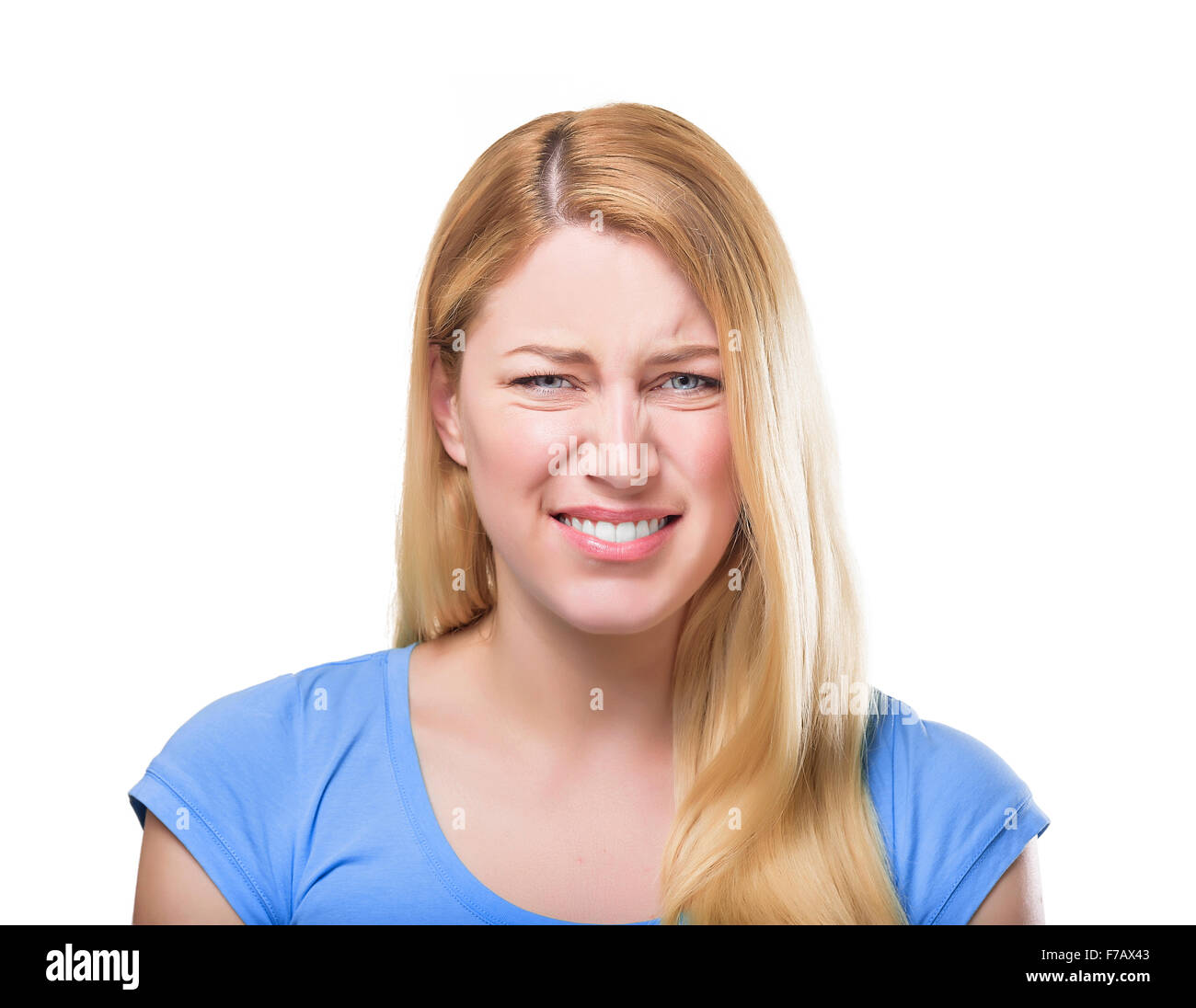 Blonde woman grimacing. - Stock Image