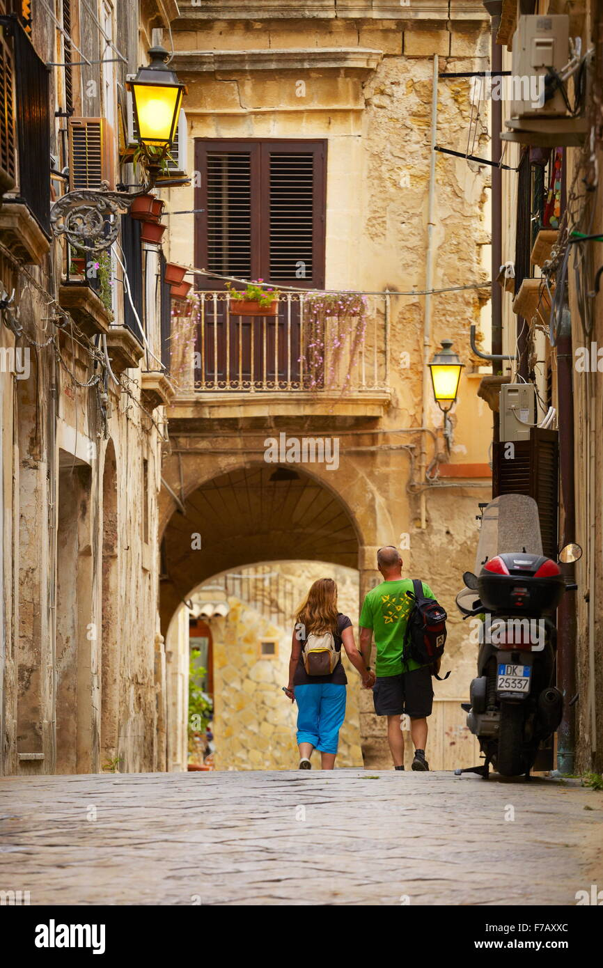 Sicily - tourists walking on the street of Syracuse Old Town, Sicily, Italy, UNESCO - Stock Image