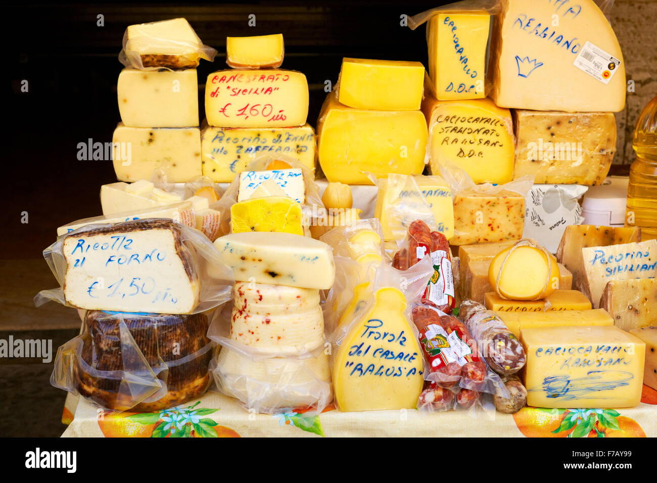 Sicilian cheese - many types of traditional sicilian cheeses, food market of Ortigia, Syracuse, Sicily, Italy - Stock Image