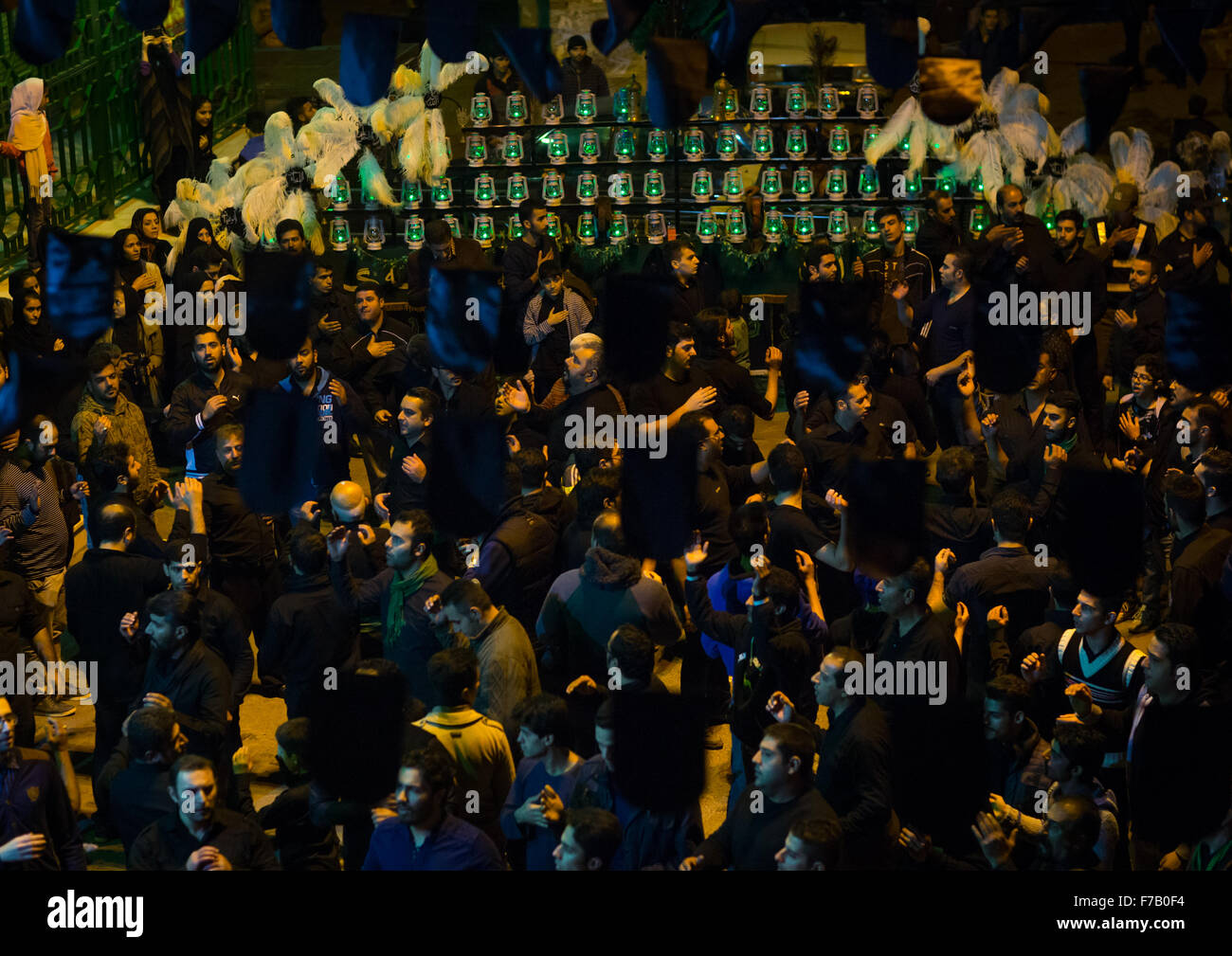 Shiite Muslim Mourners In Front Of An Alam With Forty Lamps On Ashura, The Day Of The Death Of Imam Hussein, Golestan - Stock Image