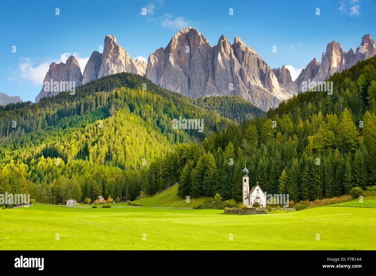 St Johann Church, Santa Maddalena, Tyrol, Dolomites Mountains landscape, Italy - Stock Image