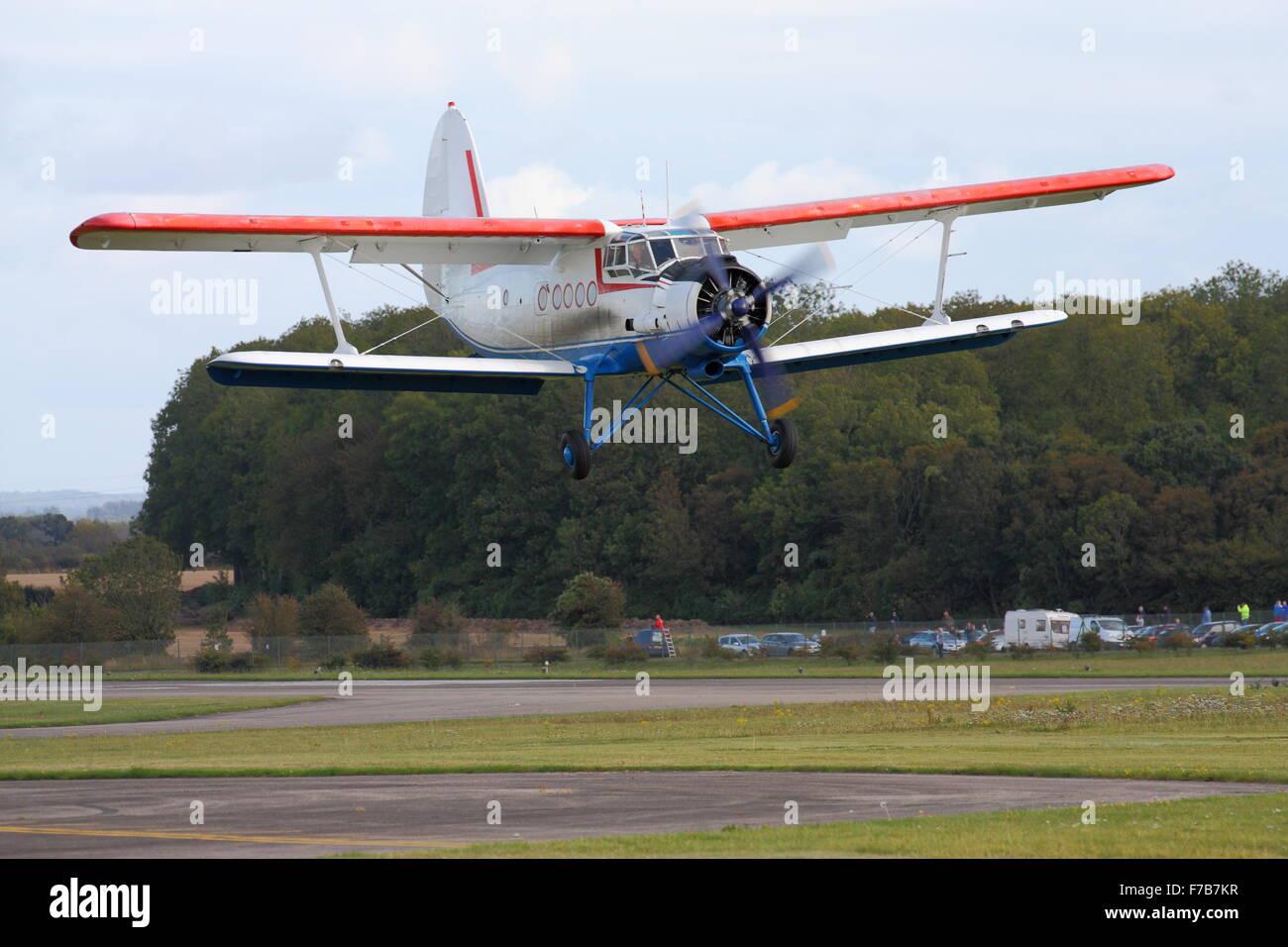 Antonov An-2 landing at Abingdon Airfield - Stock Image
