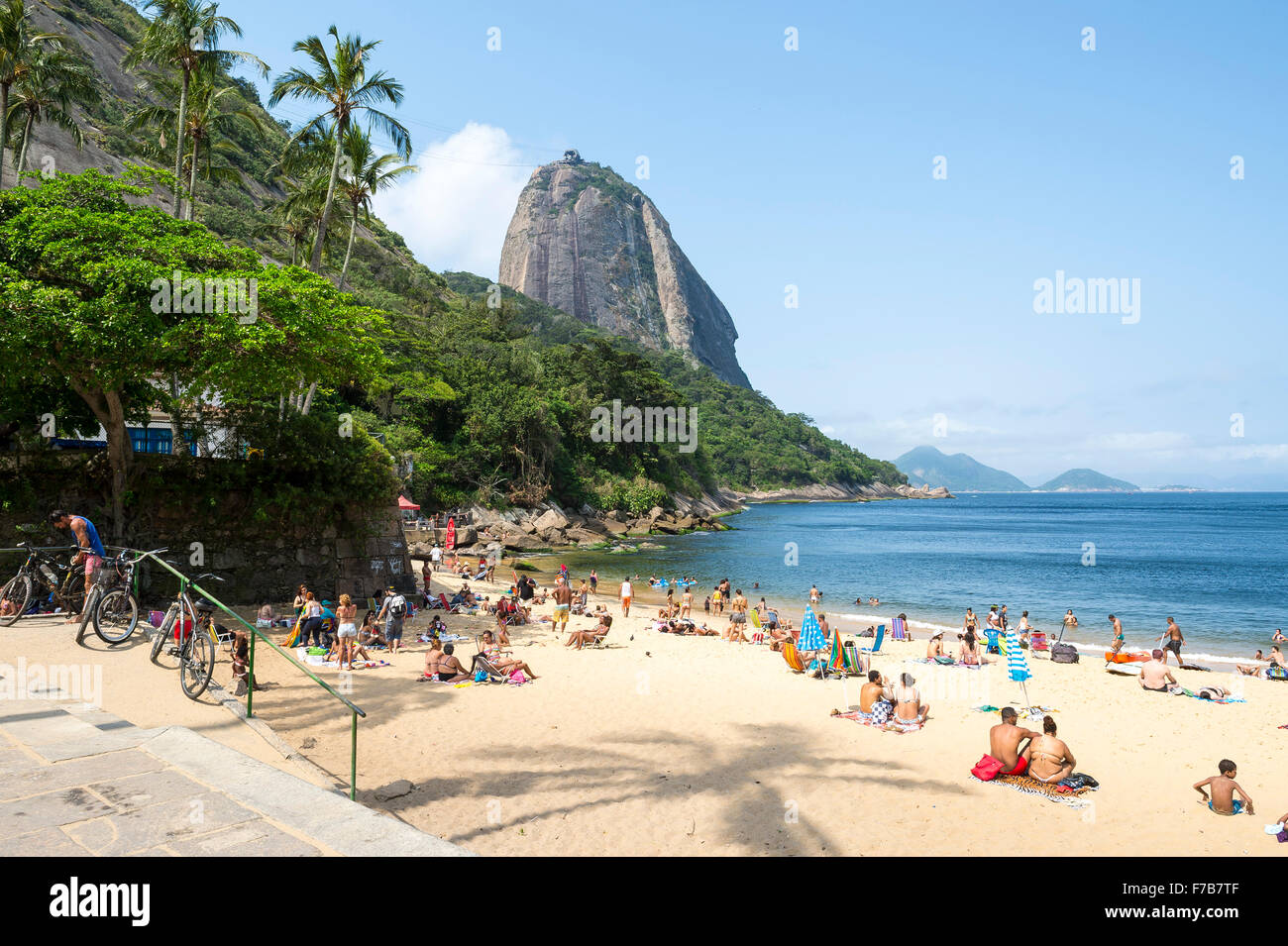 RIO DE JANEIRO, BRAZIL - OCTOBER 20, 2015: Beachgoers relax on Praia Vermelha Red Beach under a view of Sugarloaf - Stock Image