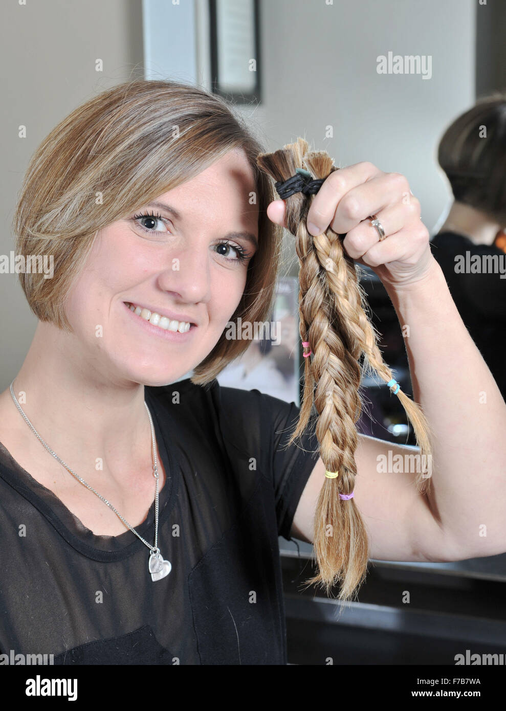 Brighton UK 24th November 2015 - Zoe Browning from Brighton is having her  hair cut off and donating it to be made into wigs for children with cancer  at the ... c189fdc22c2b