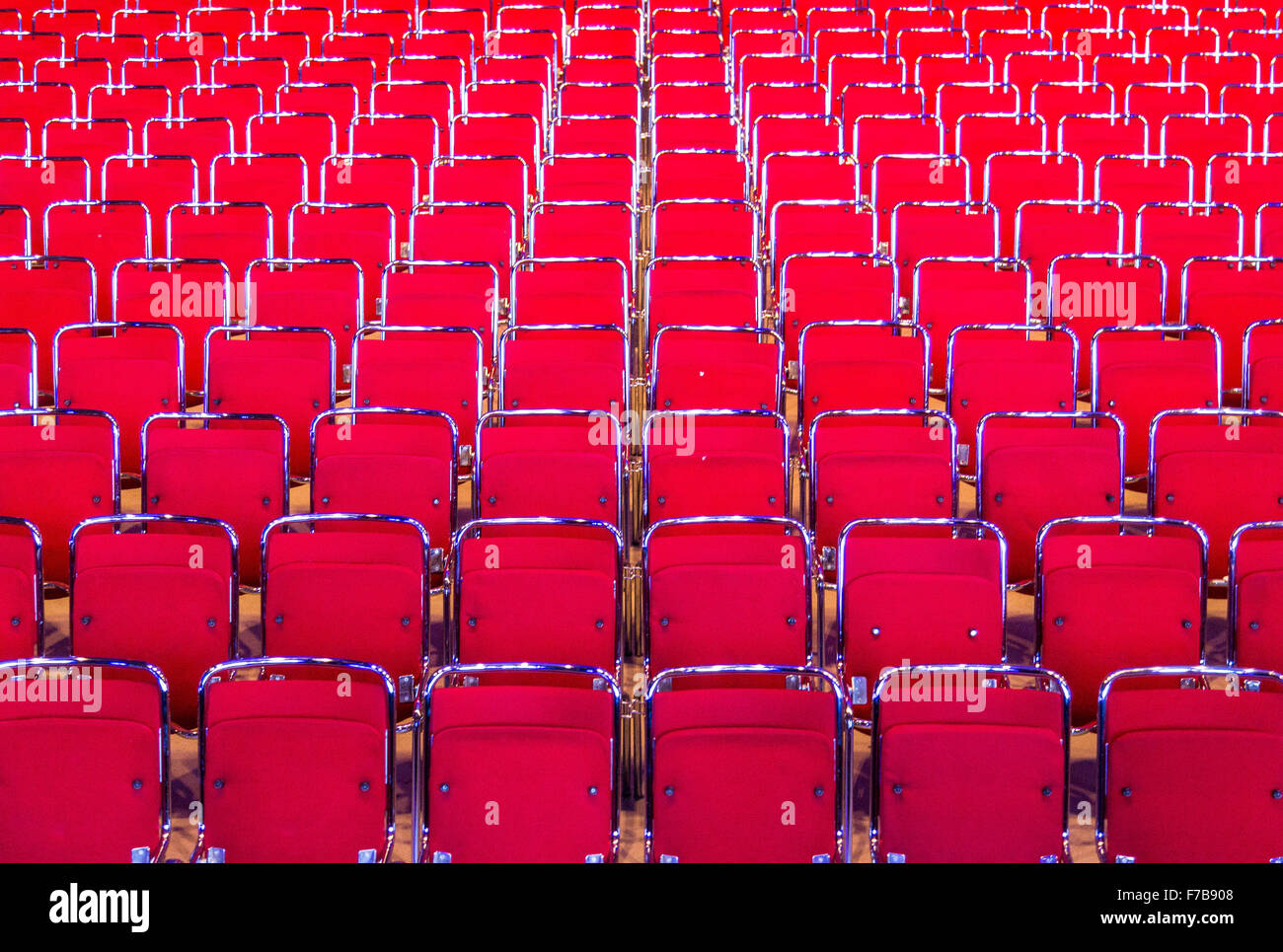 Red chairs, many rows, in an auditorium, theater, - Stock Image