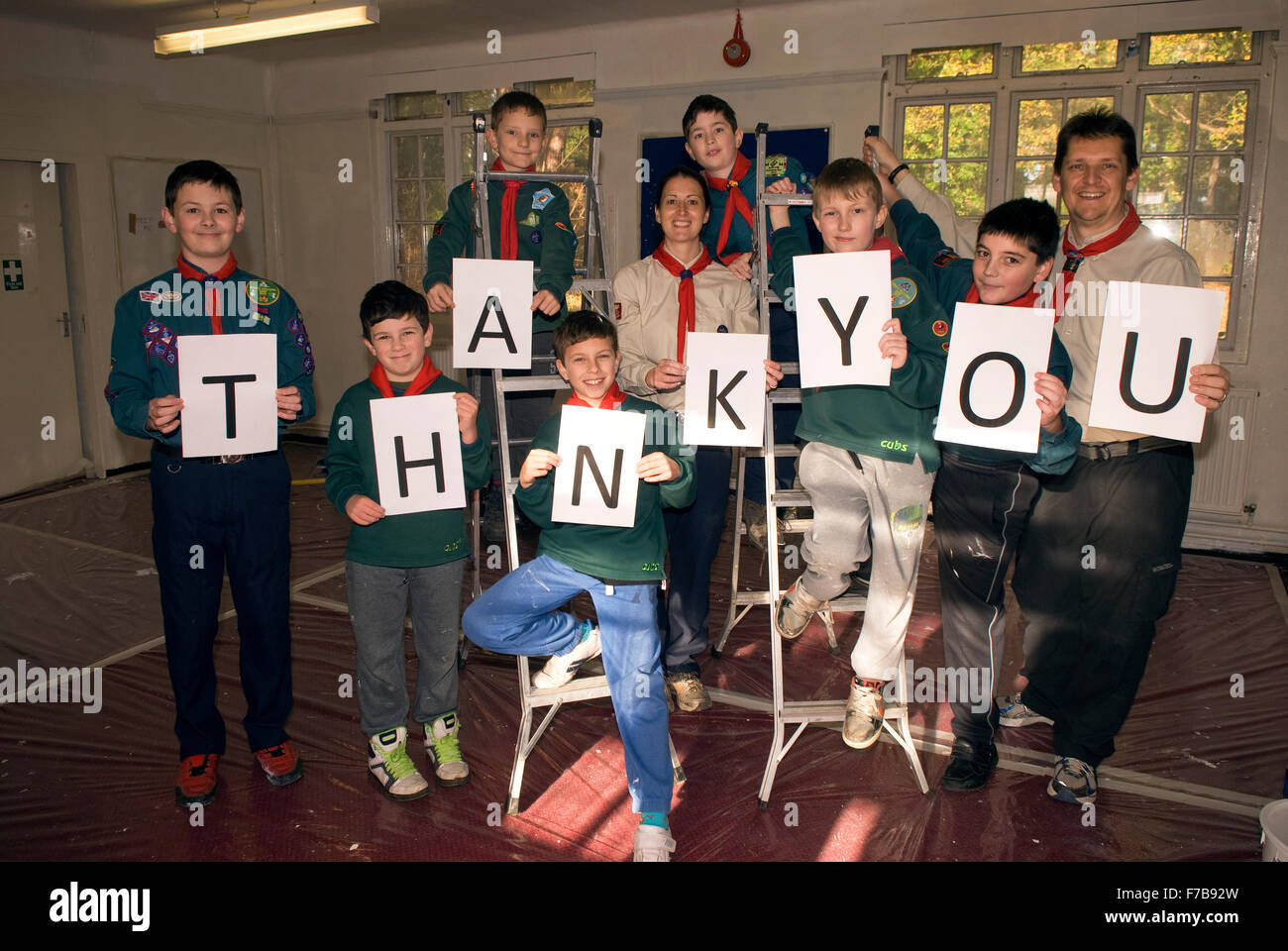 A local Cub & Scout group say 'thank you' to volunteers & sponsors for their assistance in helping - Stock Image